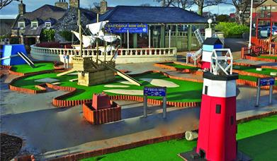 Pirate ship and lighthouse holes of crazy golf course