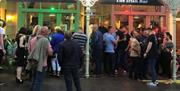 Crowds outside Irish Bar in the evening