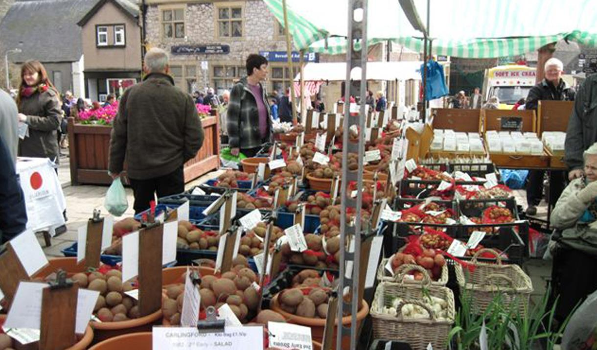 Image shows Conwy Seed Fair on Lancaster Square, Conwy